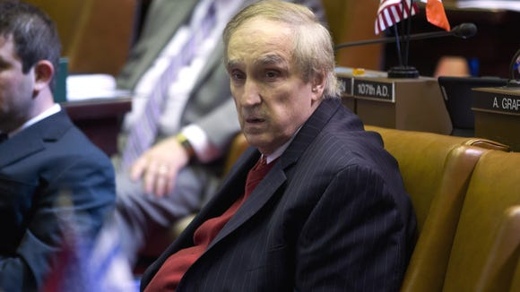Assemblyman Vito Lopez, D-Brooklyn, sits at his desk in the Assembly Chamber at the Capitol on April 30, 2013. He resigned days later after he was censured for repeated sexual harassment.