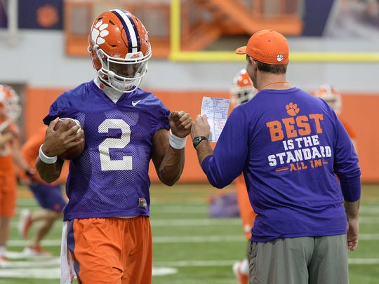 Clemson quarterback Kelly Bryant (2) bumps fists with coach Dabo Swinney during the Tigers' opening day of spring practice on March 1.
