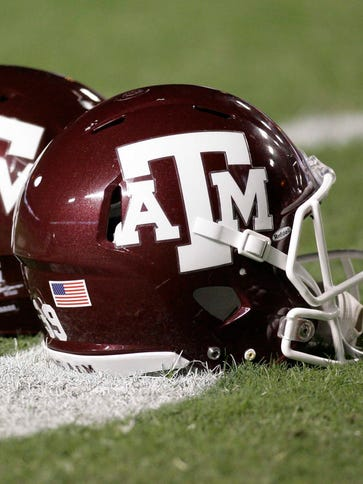 Two Texas A&M football assistant coaches brought the