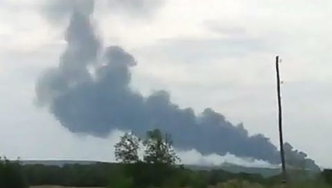 Smoke rises from the scene of a possible crash of a Malaysia Airlines passenger jet near Donetsk. The Boeing 777 jet with 280 passengers and 15 crew members crashed in Ukraine near the border with Russia.
