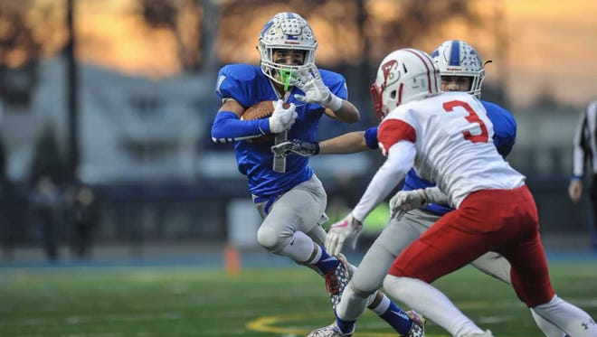 Middlesex running back Devin Lanza makes a move to get past Pt. Beach's Josh Yates in the first half of the Central Group 1 Championship game at Kean Univ. in Union on Dec. 2, 2017.