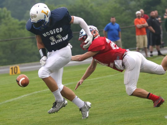 North defensive back Christian Durbin of Crestview knocks away a pass from Ontario's Ethan Pensante.