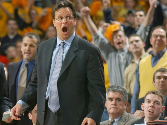 Marquette coach Tom Crean celebrates a victory over the Wisconsin Badgers in 2002 at the Bradley Center.