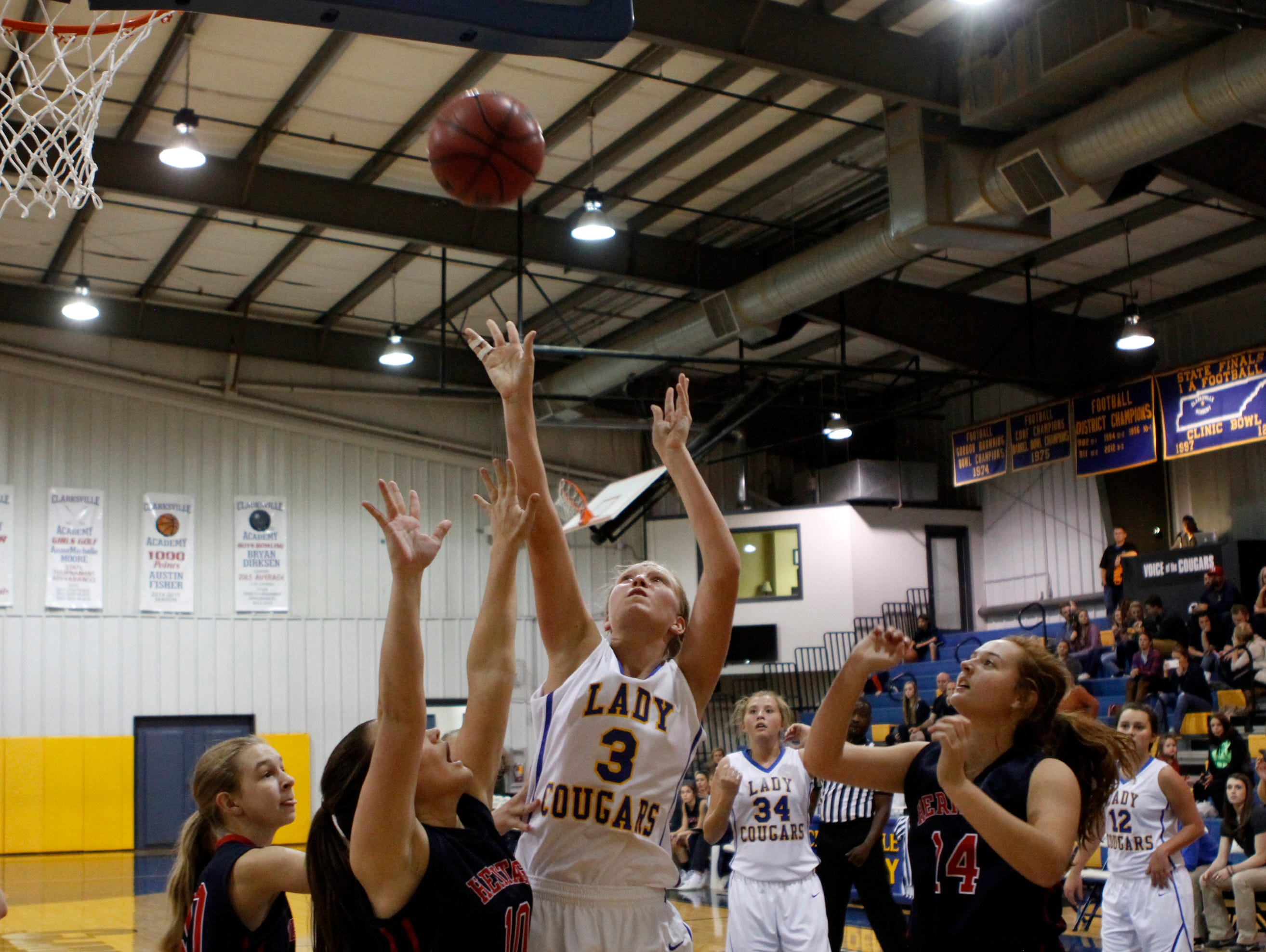 Clarksville Academy's Bailey Foote (3) was held to four points on the night as Clarksville Academy fell to White House-Heritage in a Hall of Fame game Thursday.