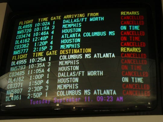 This flight information board at Alexandria International Airport on the morning of Sept. 11, 2001, showed how flights were being canceled following incidents in which airplanes were used as weapons by terrorists.  Commercial air travel was shut down for 12 days following the terrorist attacks.