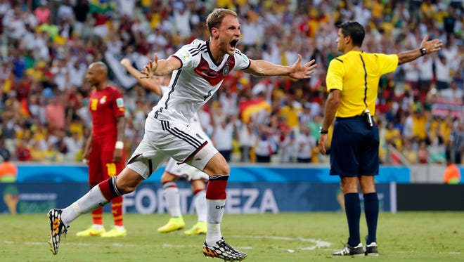 Germany's Benedikt Hoewedes celebrates after his teammate Miroslav Klose scored a goal during the group G World Cup soccer match between Germany and Ghana at the Arena Castelao in Fortaleza, Brazil, Saturday, June 21, 2014.