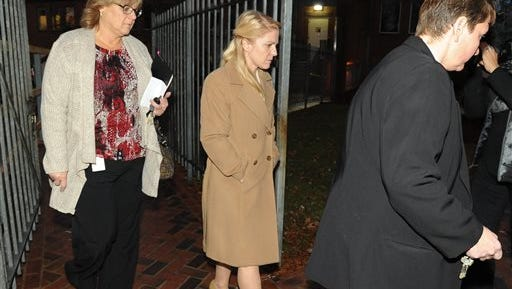 Kurt Busch's ex-girlfriend, Patricia Driscoll, center, leaves Family Court in Dover, Del. on Tuesday, Dec. 16, 2014. Driscoll has requested an order directing the NASCAR driver to stay away from her following an alleged assault at Dover International Speedway in September 2014. (AP Photo/The News Journal, Jason Minto)