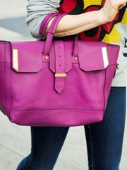 Catt Sadler will be donating a Linea Pelle purple haze handbag similar to this one to Style Swap Indy 2014.