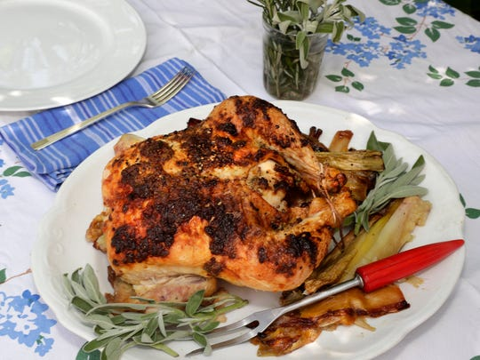A whole farm-fresh chicken is roasted in a cast-iron