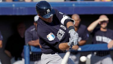 New York Yankees' Austin Romine hits a double against the Washington Nationals in the second inning of spring training baseball game, Wednesday, March 23, 2016, in Viera, Fla.