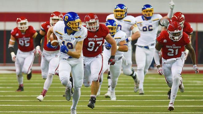 SDSU's Jake Wieneke runs the ball down the field scoring a touchdown against USD Saturday, Nov. 18, at the DakotaDome in Vermillion.
