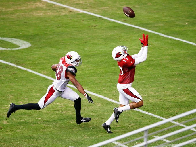 Arizona Cardinals wide receiver #17 Reggie Dunn runs for the pass during training camp Wednesday, Aug. 20, 2014 at University of Phoenix Stadium in Glendale.
