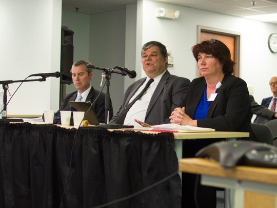 Three financial officers for the University of Vermont Health Network present revenues and expenses at the Green Mountain Care Board in Montpelier on Tuesday, April 4, 2017. From left to right: Rick Vincent, chief financial officer for the University of Vermont Medical Center; Todd Keating, chief financial officer for the University of Vermont Health Network; and Cheyenne Holland, chief financial officer for Central Vermont Medical Center.