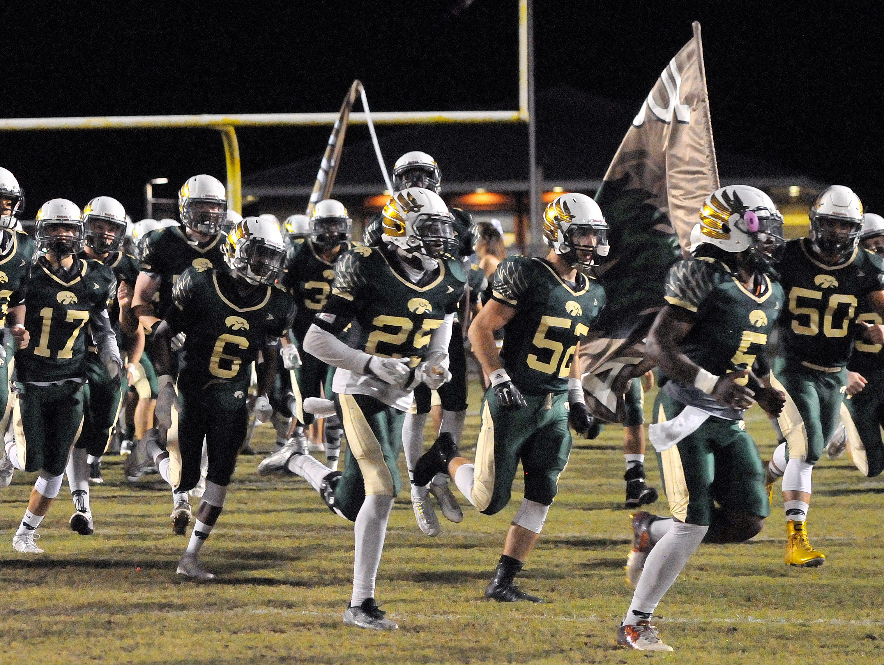 Viera High players take the field for Friday nights playoff game Against Martin County held at Viera High Stadium .
