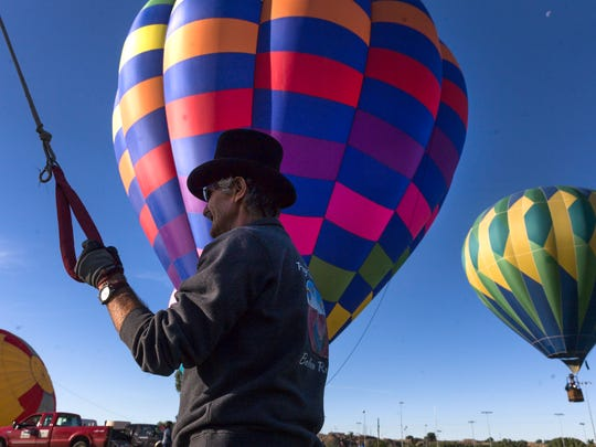 Philip Heinrich helps set up his balloon Patience, Friday, June 16, 2017 at the Chamblee Soccer Complex in Bloomfield.