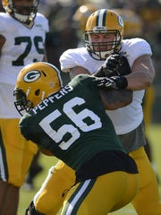 Green Bay Packers tackle Don Barclay, right, is trying to regain his form after missing all of last season with a knee injury.