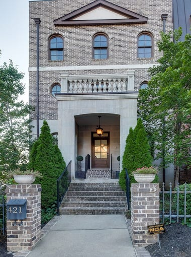 This exclusive four-story brick townhome with private, two-level rooftop terrace is located off West End Avenue and just one block from Centennial Park.