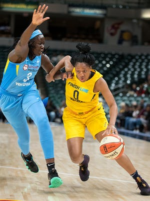 Indiana Fever guard Kelsey Mitchell (0) drives on Chicago Sky center Adut Bulgak (3) in the first half of their WNBA preseason basketball game at Bankers Life Fieldhouse on Monday, May 7, 2018.