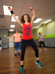 Instructor Pilar Hinde leads a Zumba dance fitness class at G3 Fitness, June 1, 2016.