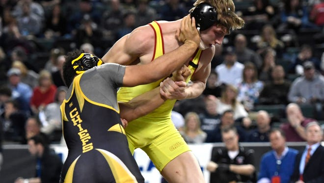 Bergen Catholic's Shane Griffith (yellow) and Piscataway's Michael Petite wrestle in the 160-pound semifinal bout during the NJSIAA wrestling championships in Atlantic City, NJ on Saturday, March 3, 2018. Griffith won by decision, 7-3.