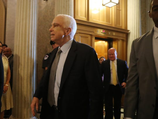 Sen. John McCain, R-Ariz., arrives on Capitol Hill Tuesday, as the Senate was to vote on moving ahead on health care with the goal of erasing much of the Affordable Care Act.