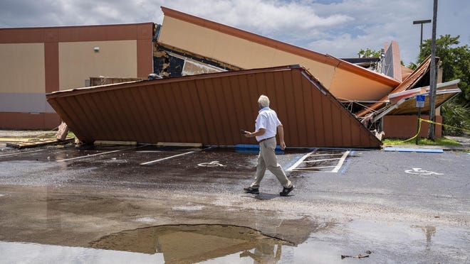 A building inspector surveys the damage after a roof collapsed near the Sunshine Flea Market on July 7, 2020 in West Palm Beach, Florida. The business was not open at the time and the cause of the collapse is being investigated.