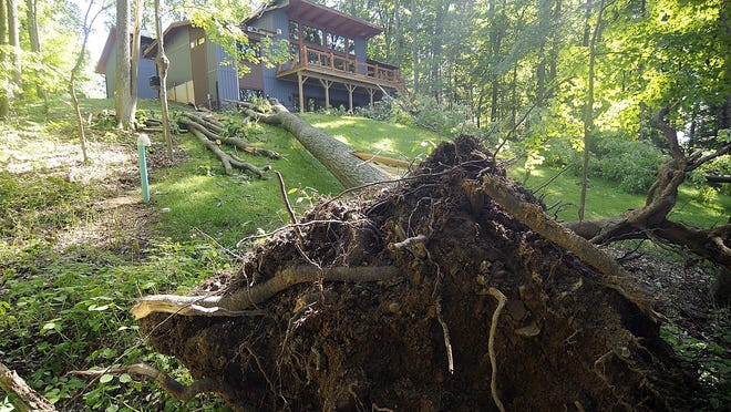 Damage from Wednesday night's storm done to this home in the Muskingum Watershed Conservacy District Richland Cottage area at Pleasant Hill Lake is shown here Friday.