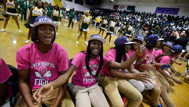 The Jeff Davis girls basketball team celebrates as the Vols receive their Class 7A state championship trophy and are honored during a ceremony at the school on Thursday.