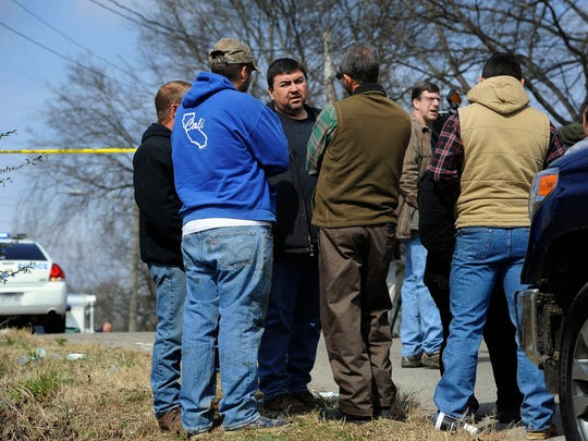Dennis White of Liberty Construction talks to employees after two members of his crew were shot on a job site.