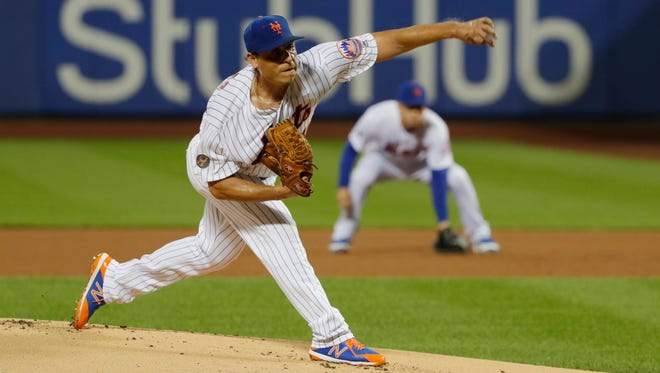 New York Mets' Jason Vargas delivers a pitch during the first inning of the team's baseball game against the Cincinnati Reds on Tuesday, Aug. 7, 2018, in New York.