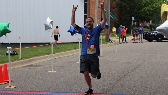Battle Creek Enquirer reporter Nick Buckley finishes the Cereal City 5K race on Saturday, June 9, 2018.