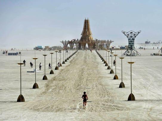 Burning Man 2017 A burner runs toward The Temple at