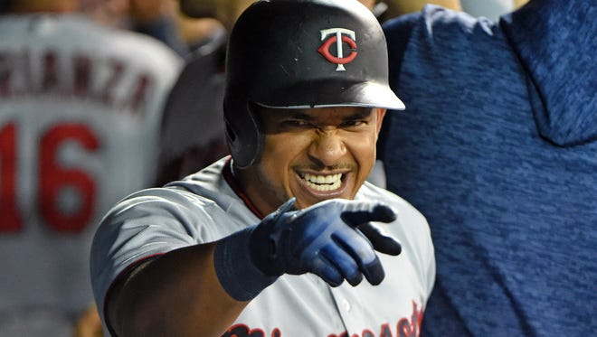 Minnesota Twins third baseman Eduardo Escobar (5) reacts in the dugout after hitting a three-run home run against the Toronto Blue Jays in the eighth inning at Rogers Centre.