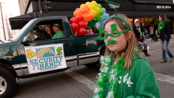 The annual St. Patrick's Day Parade moves through downtown Manitowoc in 2015.