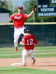 Sandusky American Legion Post 83's James Fisher doesn't stop Great Lakes Neal Post 743's Teagen Shaughnessy at second.