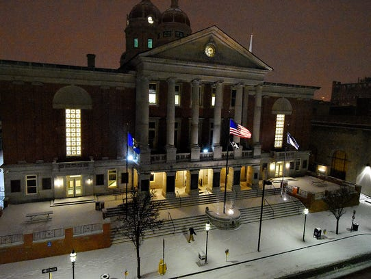 Snow begins to fall on East Market Street as Winter