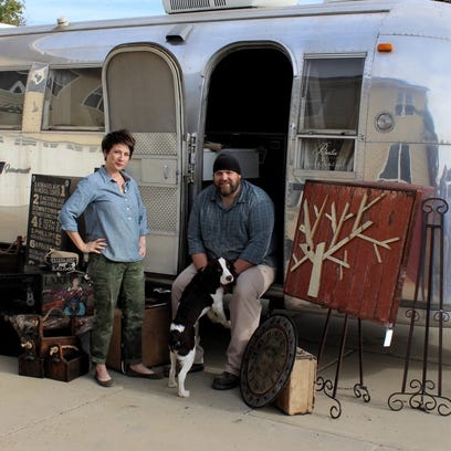 Carmen Dyar, owner of Minglewood Studios, and Tim Jorgensen, owner of Splitrock Furniture. load up for the Minglewood Traveling Trunk Show at Strawbale Winery's HarvestFest.