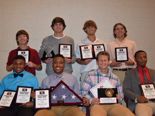 Receiving baseball awards from Clinton High are (front,