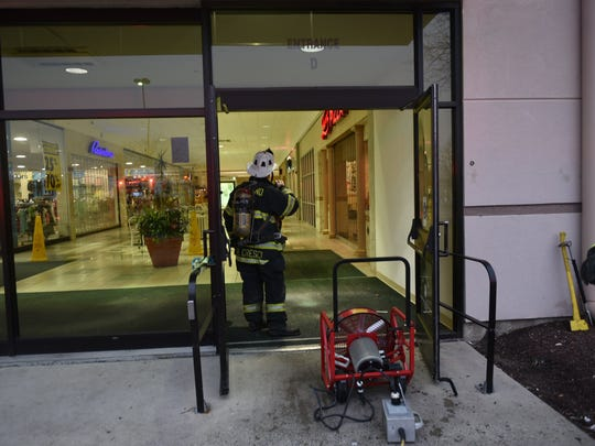 Vineland firefighters vent the Cumberland Mall of smoke.