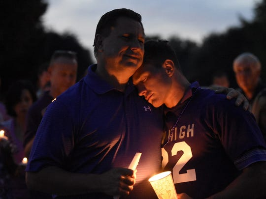 Friends and family pay their respects at a candlelight vigil for Amanda Strous on Monday night.