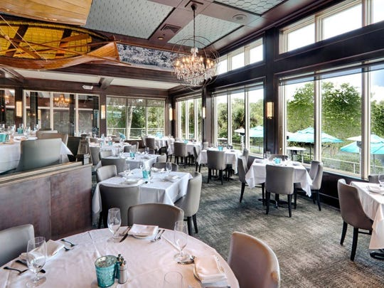 The dining room on the water was newly redone in 2015 in muted, elegant colors of the waterscape and features a hand-crafted dory and other watercraft suspended from the ceiling.