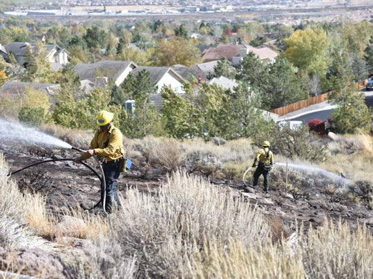 Firefighters work the scene of a small fire Friday,