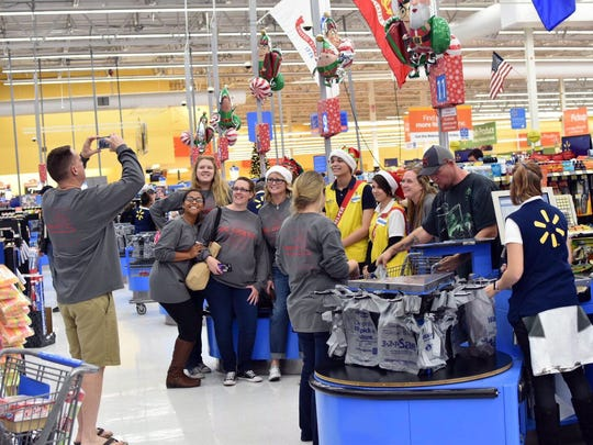 Big Givers stop to pose for a photo with local Walmart employees.This year, Walmart gifted Big Givers Christmas with a 10 percent discount.