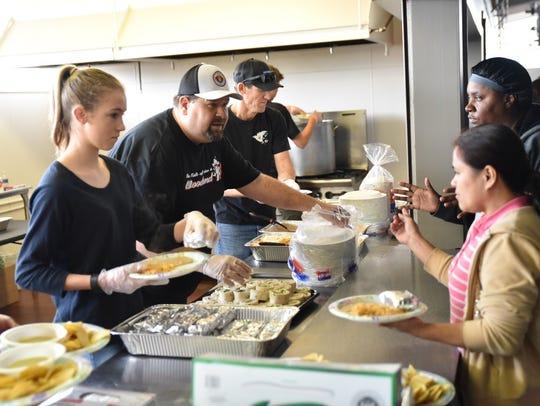 Volunteers serve lunch to almost 400 people seeking