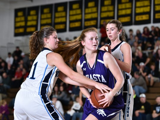 Shasta High's Madison Pulice looks for an open teammate while being double-guarded by Pleasant Valley defenders during the Northern Section Division III championship Friday at Butte College. Shasta lost 56-43.