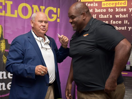 Phillip Fulmer and Antone Davis prepare to greet guests