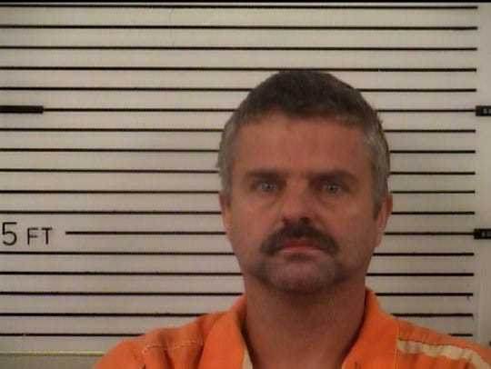 Christopher Kevin Carver, 42, faces felony charges of second degree arson and cruelty to animlas.