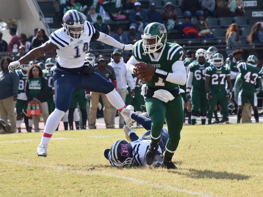 Mississippi Valley quarterback Dwayne Betts runs away from Jackson State linemen Keontre Anderson (14) and Khalil Johnson in a 24-5 loss to the Tigers.