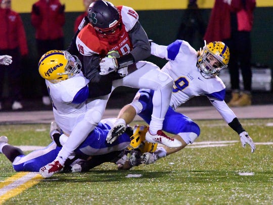 Clyde's Conner Long, left, makes a tackle Friday against