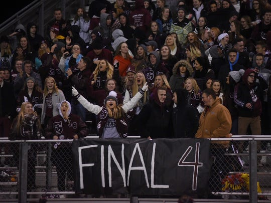 John Glenn fans cheer their Muskies on Friday night.